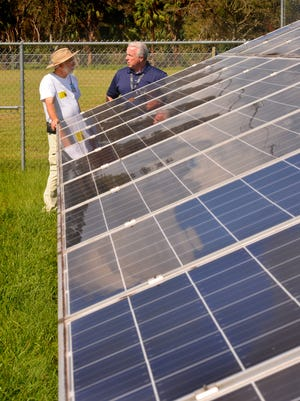 Bill Young, former lead engineer for the SunSmart Schools and Emergency Shelter Program, talks with Apollo Elementary Principal Frank O'Leary, at right, by the solar panels behind the school. Four Brevard schools received solar power systems through the program. At Apollo Elementary in Titusville, a hurricane shelter, the panels supplied power to special outlets in one of the buildings, allowing people to charge phones, make coffee, use nebulizers and even allowed a ham radio operator to stay connected during Hurricane Irma.