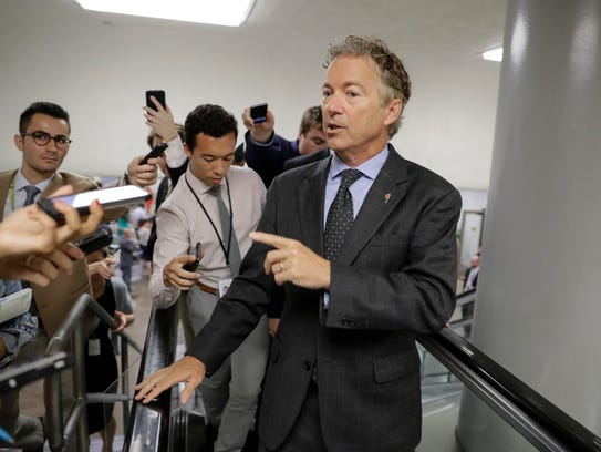 Sen. Rand Paul speaks with reporters on his way to
