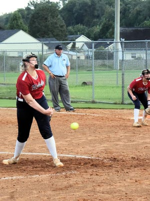 The Lady Rebels' Julia Carter pitches in the bottom of the fourth Thursday night.