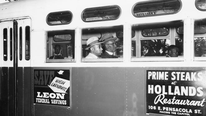 """The most iconic photo of the 1956 Tallahassee bus boycott is this one picturing Rev. C.K. Steele (by window) and Rev. H. McNeal Harris, riding at the front of a Tallahassee city bus on Dec. 24, 1956 when protesters began riding the buses in a """"non-segregated manner."""