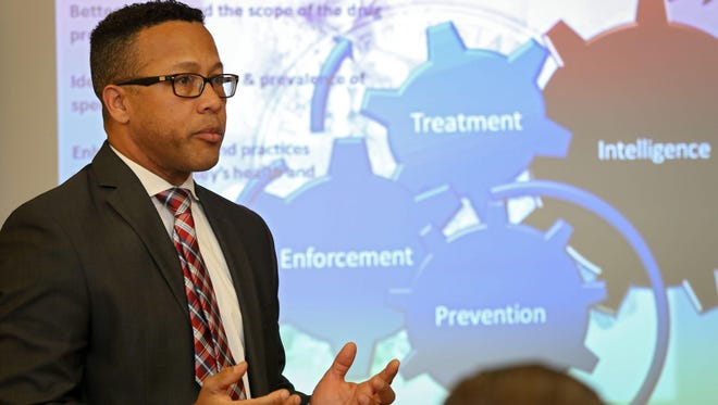 SPNJ Capt., Juan Colon speaks during a meeting held between health care professionals and state police Drug Monitoring Initiative staff, who are joining forces to track heroin sales along with the path of people seeking treatment. The meeting was held at NJSP Regional Operations Intelligence Center in Ewing, January 8, 2016.