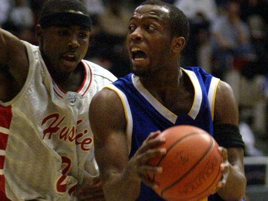 Redford's Jerome Hutchins (21) defends against Pershing's Jabari Currie (44) during the first half of Detroit's Public School League championship, Tuesday, Feb. 15, 2005, at Cobo Hall in Detroit.