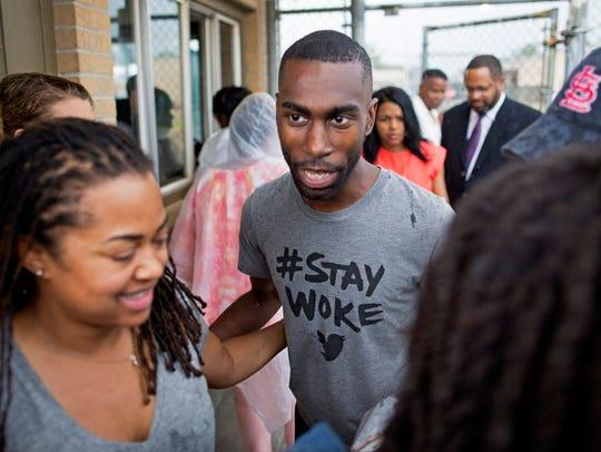 Black Lives Matter activist DeRay McKesson walks out