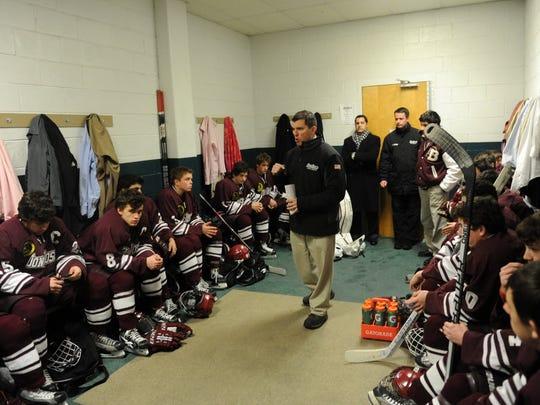 Don Bosco Prep ice hockey coach Greg Toskos (center) has turned the Ironmen into the premier program in North Jersey,