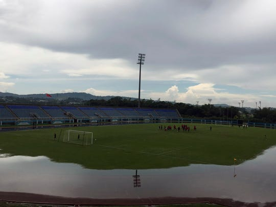 Water surrounds the field during U.S. national soccer