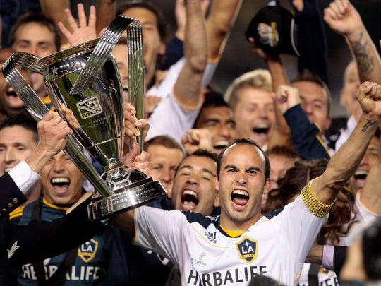 Landon Donovan holds up the MLS Cup after beating the