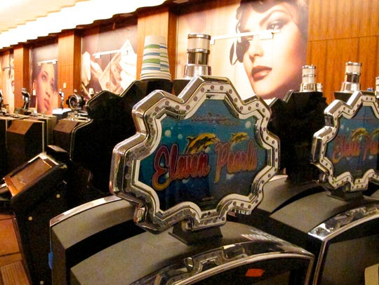 Slot machines are lined up in a hallway of the Ocean