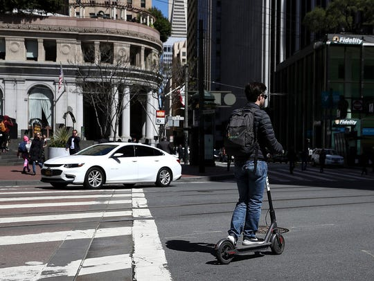 A user rides a Bird scooter on April 17, 2018 in San Francisco.