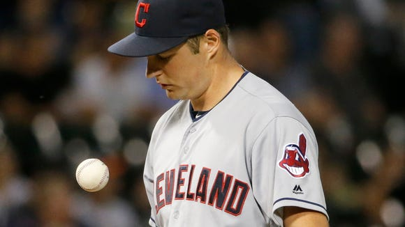 Cleveland Indians starting pitcher Trevor Bauer flips
