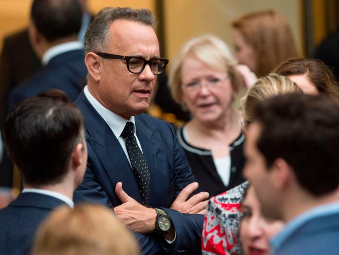 Actor Tom Hanks arrives for the unveiling of the portraits