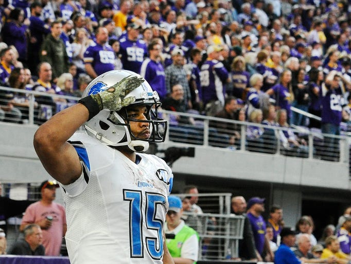 Detroit Lions wide receiver Golden Tate salutes after