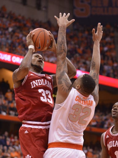 Dec 3, 2013; Syracuse, NY, USA; Indiana Hoosiers forward Jeremy Hollowell (33) shoots the ball over Syracuse Orange forward DaJuan Coleman (32) during the first half of a game at the Carrier Dome. Mandatory Credit: Mark Konezny-USA TODAY Sports