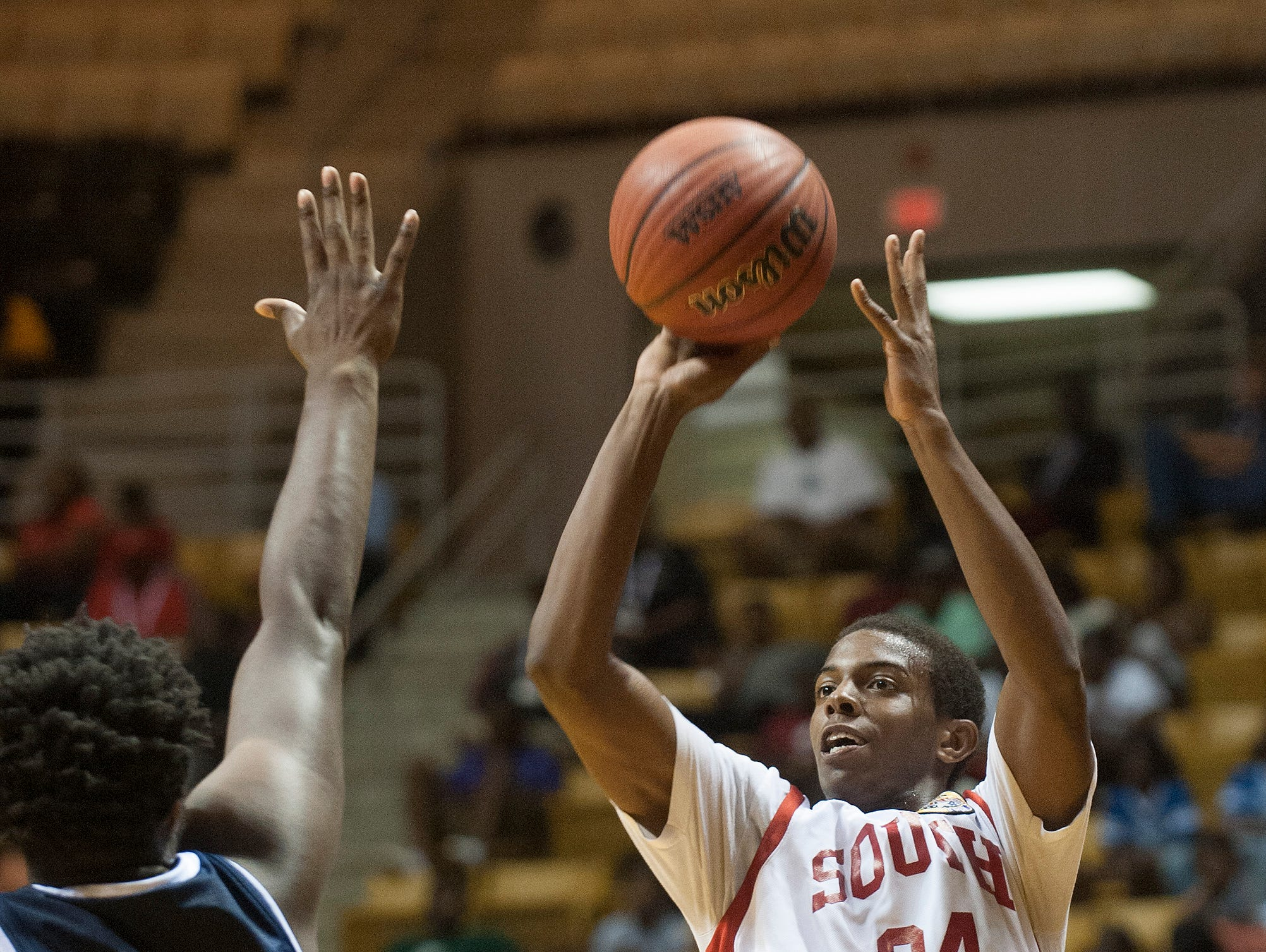 Austin Rogers (34) puts up a three pointer during the AHSAA All-Star basketball game at the Alabama State University Acadome in Montgomery, Ala., on Wednesday May 22, 2015.