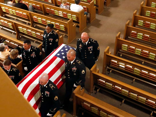 Officers from Fort Leonard Wood carry Pfc. Gerald F.