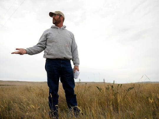 Eric Eneboe, a DNRC land manager, talks about the Conservation Reserve Program used for upland game bird habitat in Teton County on Thursday morning near Dutton.