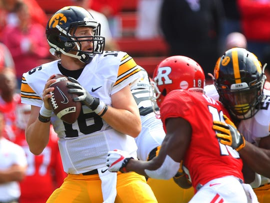 Sep 24, 2016; Piscataway, NJ, USA; Iowa Hawkeyes quarterback C.J. Beathard (16) drops back to pass during the first half of their game against the Rutgers Scarlet Knights at High Points Solutions Stadium. Mandatory Credit: Ed Mulholland-USA TODAY Sports