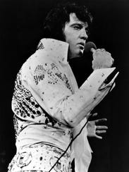 Elvis Presley performs in this 1971 file photo at an