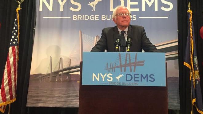 Vermont Sen. Bernie Sanders, former presidential hopeful, speaks to the New York delegation at the Democratic National Convention on Tuesday, July 26.
