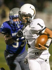 Sayreville's Colton Redding (33) gets a hand on South