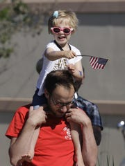 Campbell Kelter, of Illinois, rides on the shoulders of her dad, Dan, while watching the Sheboygan Fourth of July parade last year.