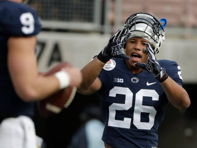 Penn State running back Saquon Barkley warms up before