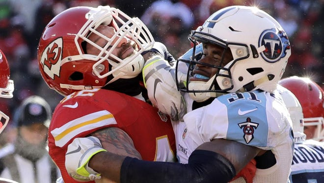 Titans safety Kevin Byard (31) hits Chiefs running back Anthony Sherman (42) during the first half on Dec. 18, 2016.
