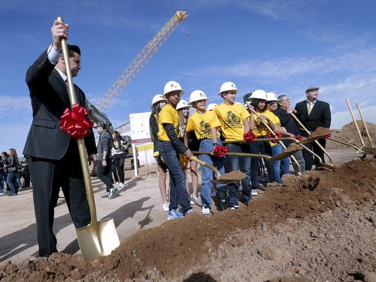 Ysleta Independent School District Superintendent Dr. Xavier de la Torre stands by as Parkland Middle School students have their turn during the ceremonial groundbreaking ceremony for the school's renovation which is part of the 2015 YISD bond.