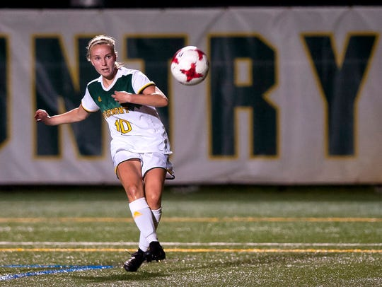 University of Vermont forward Ella Bankert fires a