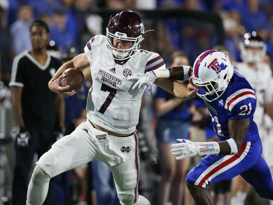 Mississippi State's Nick Fitzgerald (7) breaks free