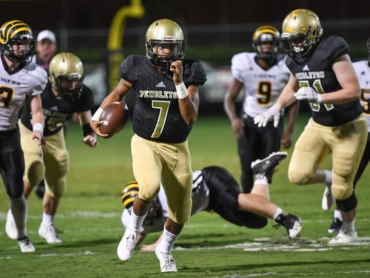Pendleton junior Jamal Blakley (7) runs by Crescent