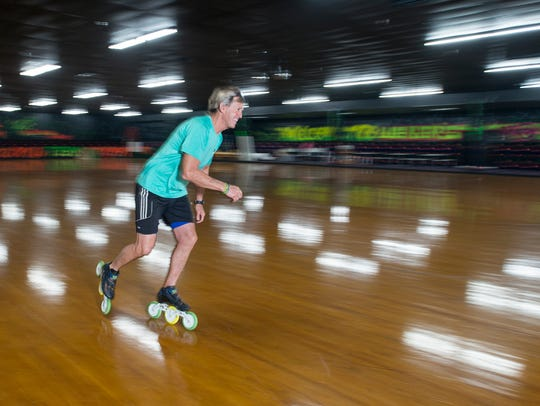David Weber, owner of Weber's Skate World, skates around the Milton rink on Monday. Weber is the 2015 USA Roller Sports esquire men's national champion speed skater.