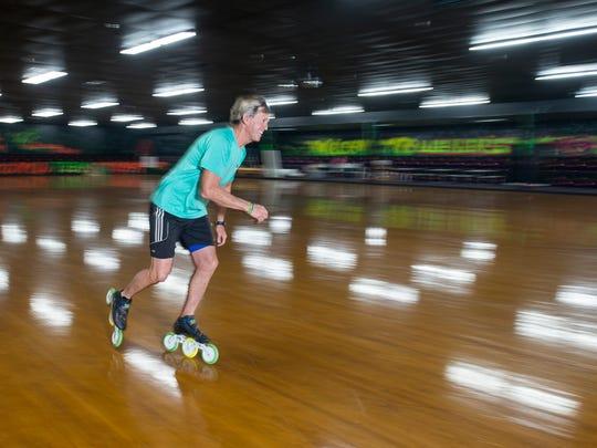 David Weber, owner of Weber's Skate World, skates around the Milton rink on Monday. Weber is the 2015 USA Roller Sports esquire men's national champion speed skater.
