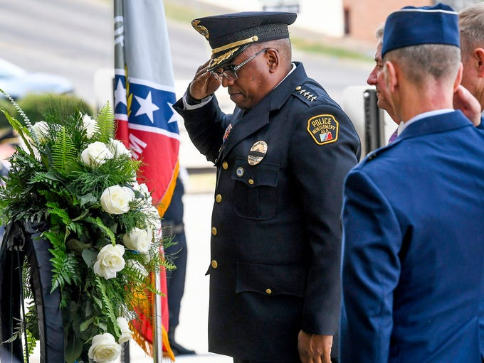 Montgomery Police Chief Ernest Finley, Jr., salutes