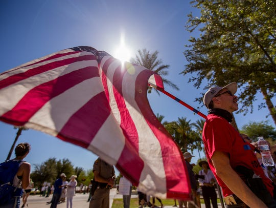 A member of the Patriot Movement Arizona argues with