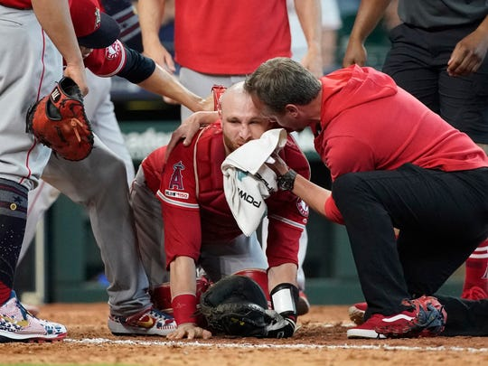 Los Angeles Angels catcher Jonathan Lucroy, a former Ragin' Cajun, is helped by medical personnel after colliding with the Houston Astros' Jake Marisnick during a game last Sunday.