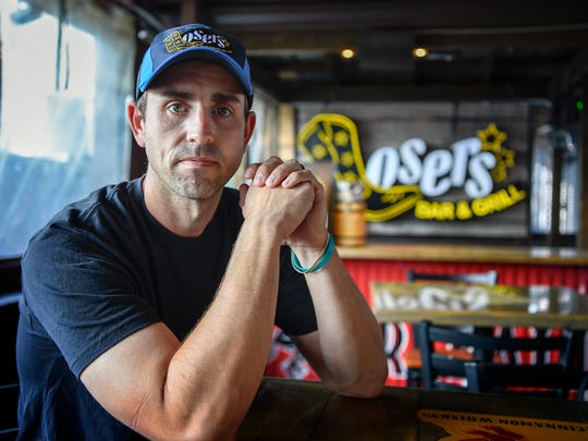 Jacob Waddell, 36, of Nolensville posses for a portrait at the Losers Bar in Nashville, Tenn., Wednesday, May 31, 2017.
