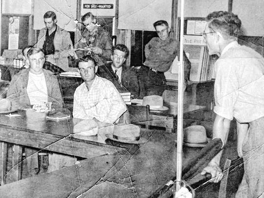 Norval Dvorak, right, teaches farm management to a group of World War II veterans at the old Mishicot High School in the late 1940s. He taught nearly 50 veterans during the program's 10 years.
