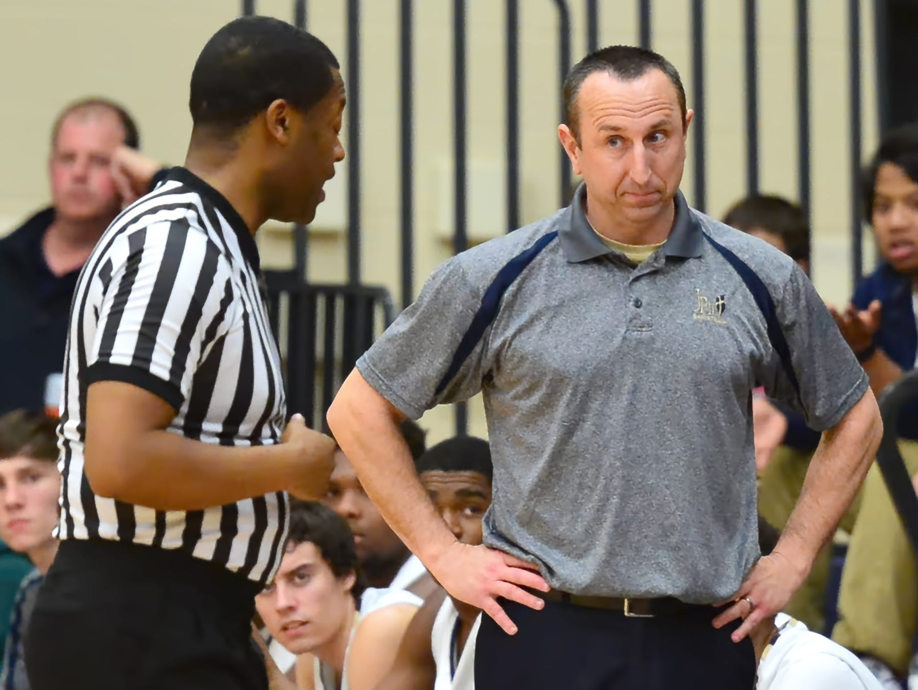 Kip Brown gets an explanation from an official during a game earlier this year. Brown - who compiled a 90-57 record over five seasons at Pope John Paul II High - has accepted the head-coaching position at his alma mater, Beech High.