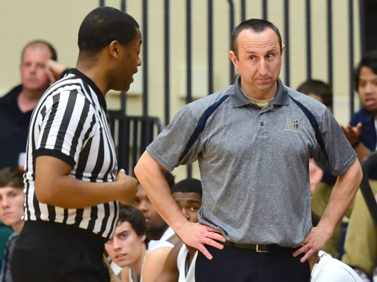 Kip Brown gets an explanation from an official during a game last season.. Brown - who compiled a 90-57 record over five seasons at Pope John Paul II High - is the new coach at his alma mater, Beech High.