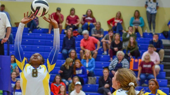 Eastside's Kaity Freeman (8) sets up a spike by Morgan Usher (11) during the Eagles' 3-2 win over South Aiken in a Class AAAA volleyball second-round match Tuesday night.