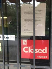 A sign in the window about the closing of Ella Jean's