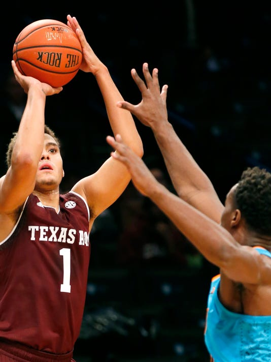 Texas A&M forward DJ Hogg, left, shoots as Oklahoma State forward Cameron McGriff, right,  defends during the first half of Game 1 of the Legends Classic college basketball tournament, Monday, Nov. 20, 2017, in New York. (AP Photo/Kathy Willens)