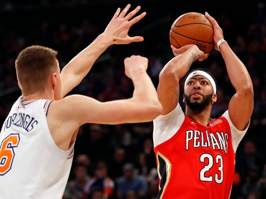 Jan 14, 2018; New York, NY, USA; New Orleans Pelicans forward Anthony Davis (23) shoots over New York Knicks forward Kristaps Porzingis (6) during the first half at Madison Square Garden. Mandatory Credit: Adam Hunger-USA TODAY Sports