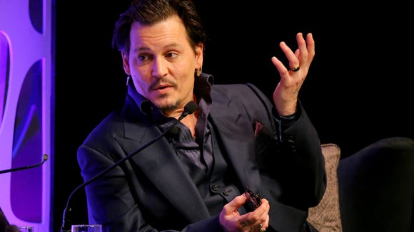 Johnny Depp speaks onstage at the Maltin Modern Master