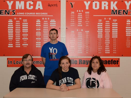 Niki Price of the York YMCA signs her letter of intent to swim at Penn State.