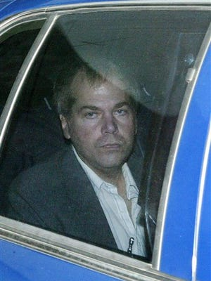 FILE-In this Nov. 18, 2003 file photo, John Hinckley Jr. arrives at U.S. District Court in Washington. Hinckley Jr. is currently awaiting a decision from a federal judge in Washington about whether he will be allowed to live full-time outside a mental hospital where he has been since being found not guilty by reason of insanity in the 1981 shooting that wounded Reagan and three others. (AP Photo/Evan Vucci, File)
