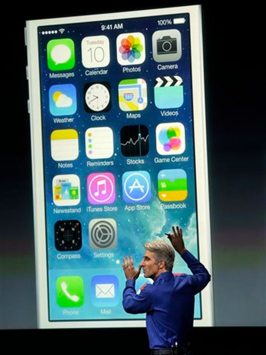 In this file photo, Craig Federighi, senior vice president of Software Engineering at Apple, speaks about the iOS 7 release in Cupertino, Calif.