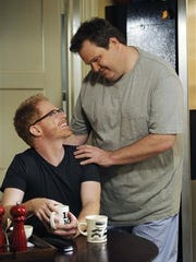 "Jesse Tyler Ferguson (left) portrays Mitchell Pritchett and Eric Stonestreet is  Cameron Tucker in ""Modern Family."""