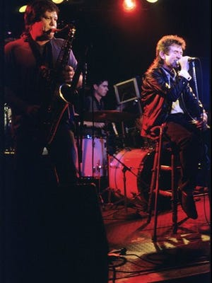FILE--In this May 12, 1987 file photo, Ronnie Lane, right, along with Bobby Keys on saxophone, join The Tremors at the Steamboat, in Austin, Texas.    Keys, who performed on recordings with John Lennon and Eric Clapton, has died at his home in Franklin, Tennessee. He was 70 years old. Michael Webb, who played keyboard with Keys, said Keys died on Tuesday, Dec. 2, 2014,  after a lengthy illness. Keys had been out on tour with the Rolling Stones earlier this year before his health prevented him from performing. (AP Photo/Austin American-Statesman, Casey Monahan)  AUSTIN CHRONICLE OUT, COMMUNITY IMPACT OUT, INTERNET AND TV MUST CREDIT PHOTOGRAPHER AND STATESMAN.COM, MAGS OUT