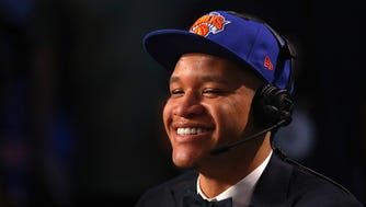 NEW YORK, NY - JUNE 21:  Kevin Knox speaks with media after being drafted ninth overall by the New York Knicks during the 2018 NBA Draft at the Barclays Center on June 21, 2018 in the Brooklyn borough of New York City. NOTE TO USER: User expressly acknowledges and agrees that, by downloading and or using this photograph, User is consenting to the terms and conditions of the Getty Images License Agreement.  (Photo by Mike Stobe/Getty Images) ORG XMIT: 775157664 ORIG FILE ID: 980765400